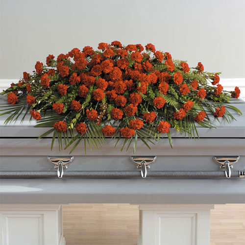 A full casket spray of robust, red carnations makes an impressive display for that someone special.<br/><br/>