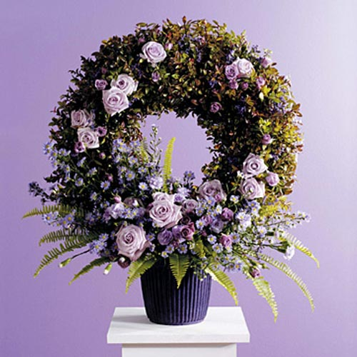Wreath in Container with Floral Accents