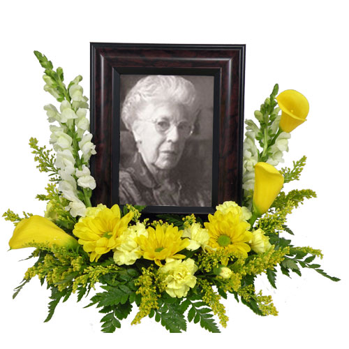 A Wylie Flower Shop exclusive tribute design. A memories design that is fitting for a celebration party whether an anniversary or a life well lived.<br/><br/>