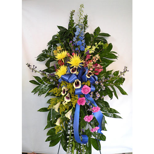 A Wylie Flower Shop exclusive tribute. A beautiful standing easel of bright exotic flowers with ribbons honoring the memory of a family member, loved one, or friend. <br/><br/>
