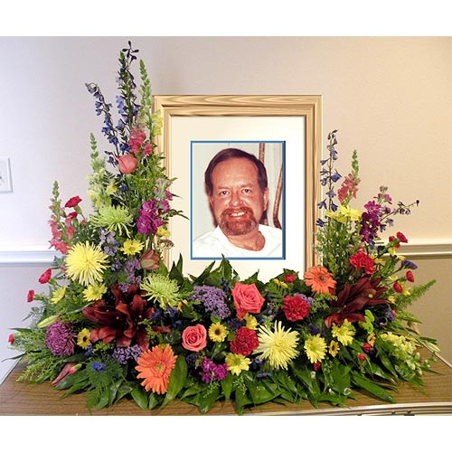 A Wylie Flower Shop tribute exclusive. This tribute arrangement is a beautiful exotic floral frame to memorialize a loved one while sharing remembrances with all.<br/><br/>