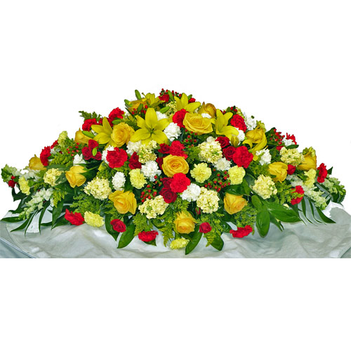 Wylie Flower Shop exclusive sympathy tribute. The beautiful colors of sunrise and sunset will remind everyone of the bright spirit of the loved one or friend whose life is being celebrated.<br/><br/>