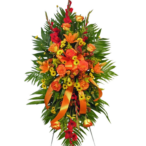 A Wylie Flower Shop sympathy tribute exclusive. This beautiful design showcases the colors of the sun to help you expresses sympathies for a friend or loved one. <br/><br/>