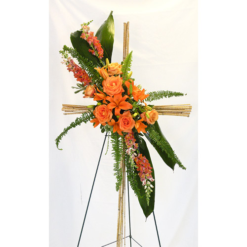 A Wylie Flower Shop tribute exclusive. Acknowledging deep devotion, this unique cross is a simply stunning way to honor the deceased, while delivering a message of faith and hope to the mourning.<br/><br/>