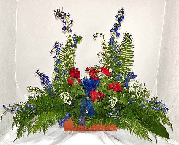 A Wylie Flower Shop exclusive. The uniqueness of this arrangement is that it combines the beautiful fresh flowers with a long lasting plant. This designer piece is recommended for any occasion where an immediate and continue appreciation is desired.<br/><br/>