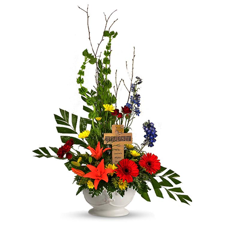 A Wylie Flower Shop exclusive. A peaceful garden of colorful flowers surrounding a tribute cross can help to express your condolences for the loss of a friend or colleague.<br/><br/>