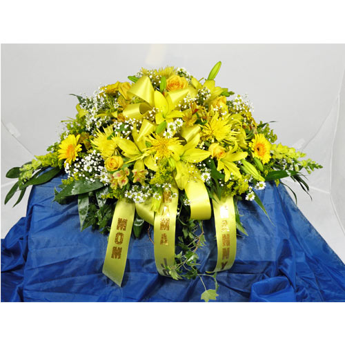 A Wylie Flower Shop exclusive. This vibrant yellow casket spray serves to remind all of fond memories and the bright spirit of the loved one or friend whose life is being celebrated.<br/><br/>