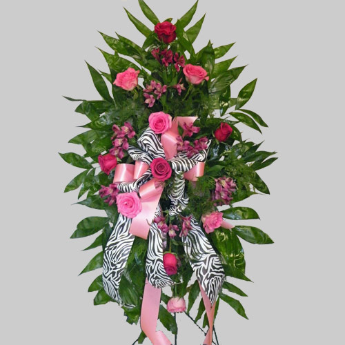 A Wylie Flower Shop exclusive tribute. Very popular and trendy zebra print ribbon combined with hot pink make a unique tribute in remembrance of a friend or loved one. <br/><br/>