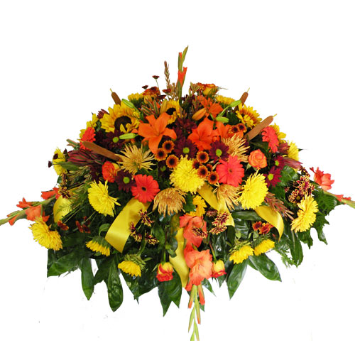 A Wylie Flower Shop exclusive tribute design. The classic colors of Fall flourish in this beautiful casket spray design.<br/><br/>
